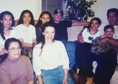 Francis with her grandmother and the rest of her family gathered in the U.S.