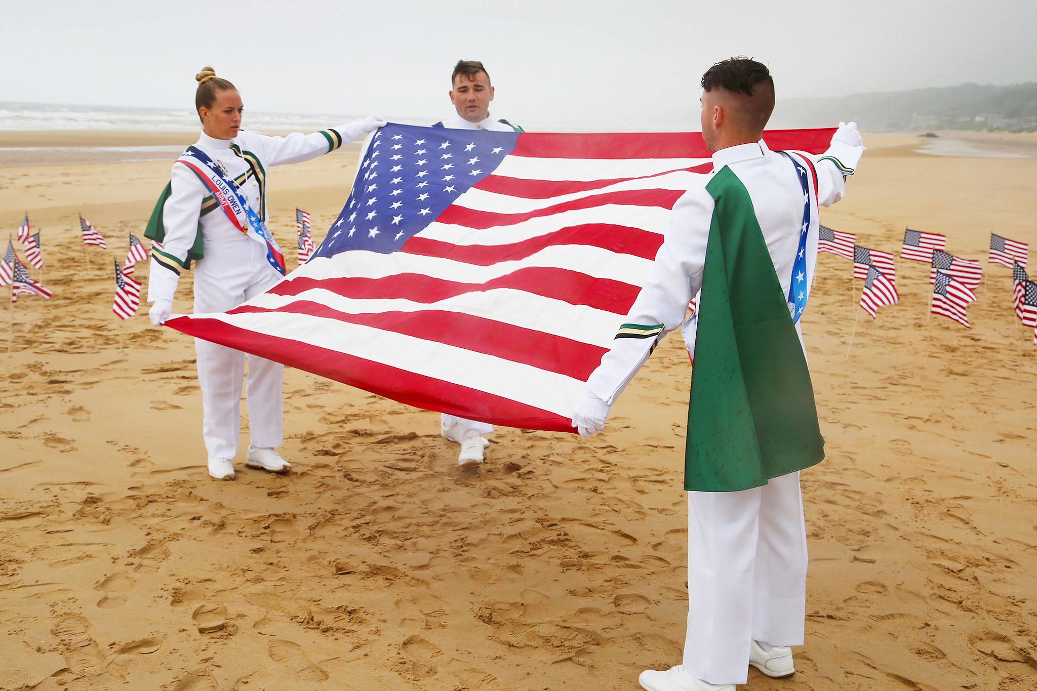 Drum majors with American flag