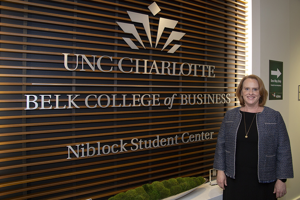 Dean Jennifer Troyer in front of the Niblock Student Center