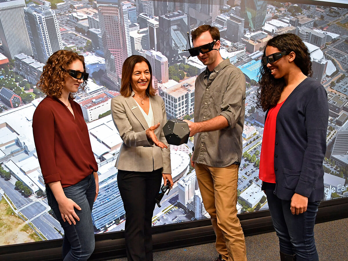 Dr. Fatma Mili, Dean of CCI, works with students in the Visualization Center.